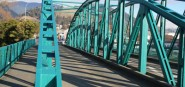 A green iron bridge.